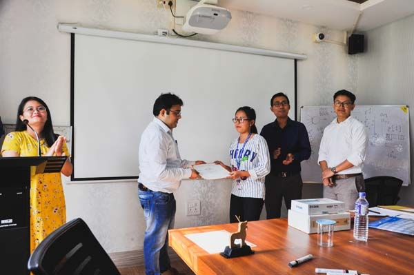 Students receiving participation certificate from the expert (Dr. Soumyajit Poddar, Asst. Prof, Dept. of ECE, IIIT Guwahati)
